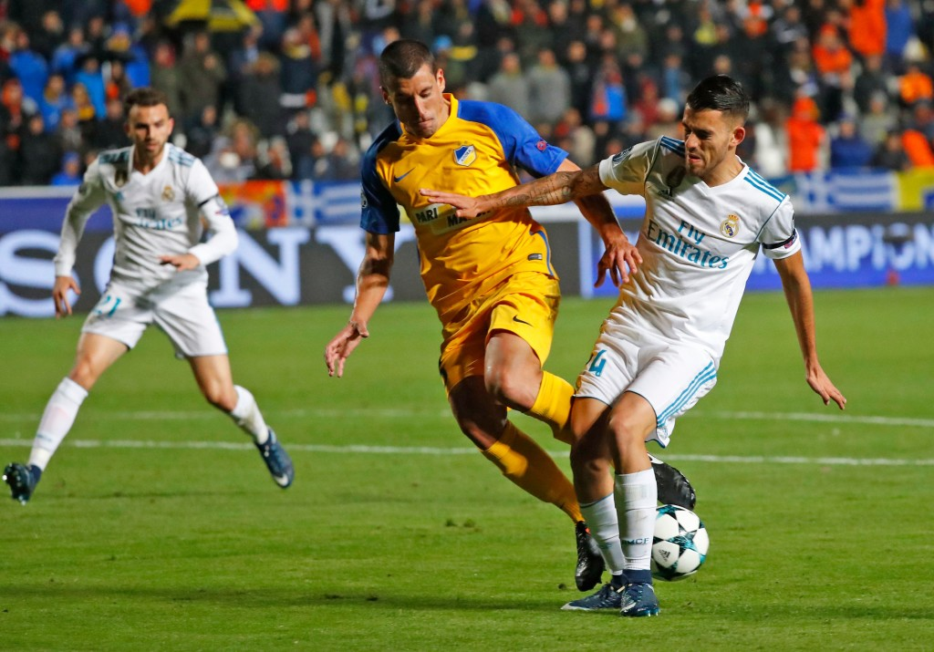 Real Madrid's Spanish midfielder Dani Ceballos (R) vies for the ball with Apoel's Spanish midfielder Jesus Rueda (C) during the UEFA Champions League Group H match between Apoel FC and Real Madrid on November 21, 2017, in the Cypriot capital Nicosia's GSP Stadium. / AFP PHOTO / Jack GUEZ (Photo credit should read JACK GUEZ/AFP/Getty Images)