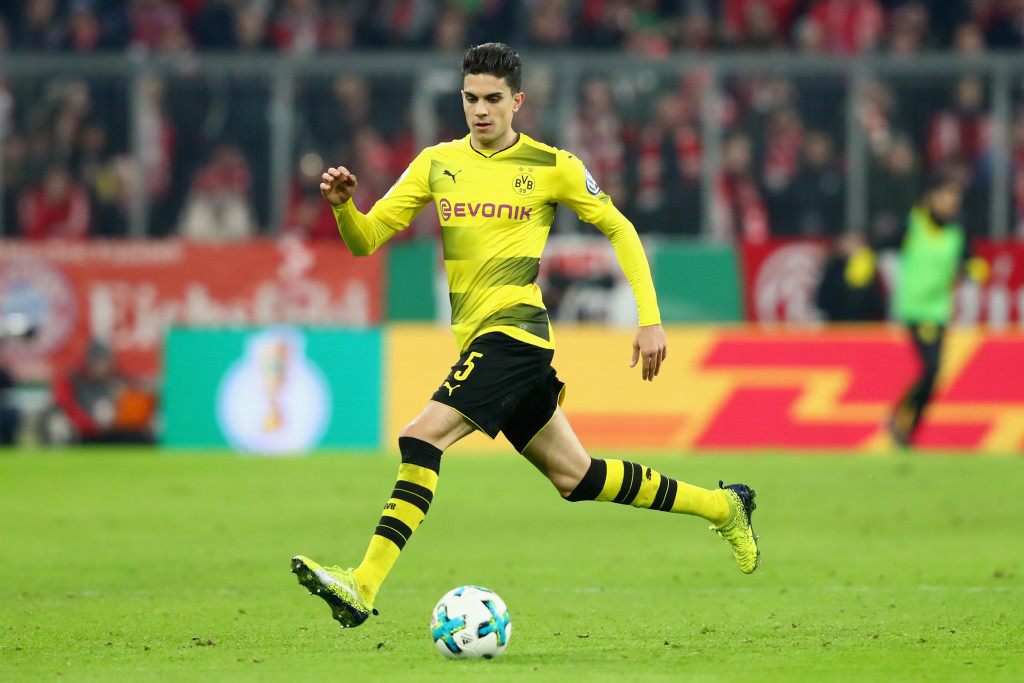 MUNICH, GERMANY - DECEMBER 20: Marc Bartra of Dortmund runs with the ball during the DFB Cup match between Bayern Muenchen and Borussia Dortmund at Allianz Arena on December 20, 2017 in Munich, Germany. (Photo by Alexander Hassenstein/Bongarts/Getty Images)