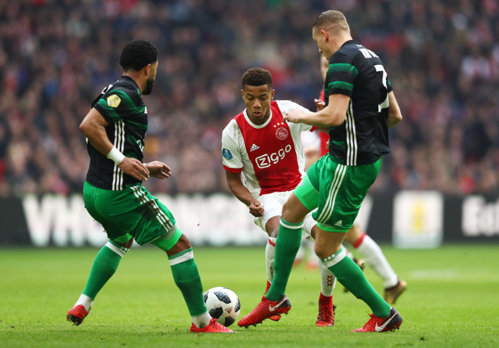 AMSTERDAM, NETHERLANDS - JANUARY 21: David Neres of Ajax takes on Sven van Beek and Tonny Vilhena of Feyenoord during the Dutch Eredivisie match between Ajax Amsterdam and Feyenoord at Amsterdam ArenA on January 21, 2018 in Amsterdam, Netherlands. (Photo by Dean Mouhtaropoulos/Getty Images)