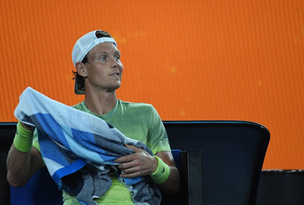 Czech Republic's Tomas Berdych uses a towel against Switzerland's Roger Federer during their men's singles quarter-finals match on day 10 of the Australian Open tennis tournament in Melbourne on January 24, 2018. / AFP PHOTO / WILLIAM WEST / -- IMAGE RESTRICTED TO EDITORIAL USE - STRICTLY NO COMMERCIAL USE -- (Photo credit should read WILLIAM WEST/AFP/Getty Images)