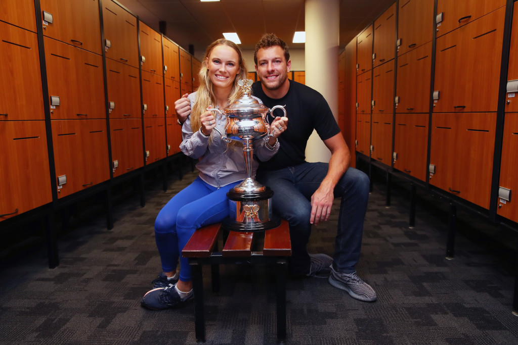 MELBOURNE, AUSTRALIA - JANUARY 27: Caroline Wozniacki of Denmark and fiance David Lee pose with the Daphne Akhurst Trophy in the locker-room after winning the Women's Singles Final against Simona Halep of Romania on day 13 of the 2018 Australian Open at Melbourne Park on January 27, 2018 in Melbourne, Australia. (Photo by Clive Brunskill/Getty Images)