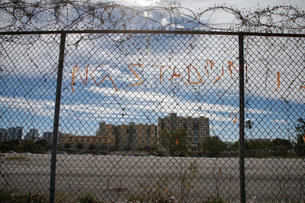 The words 'No Stadium' spelled out on the surrounding fence.
