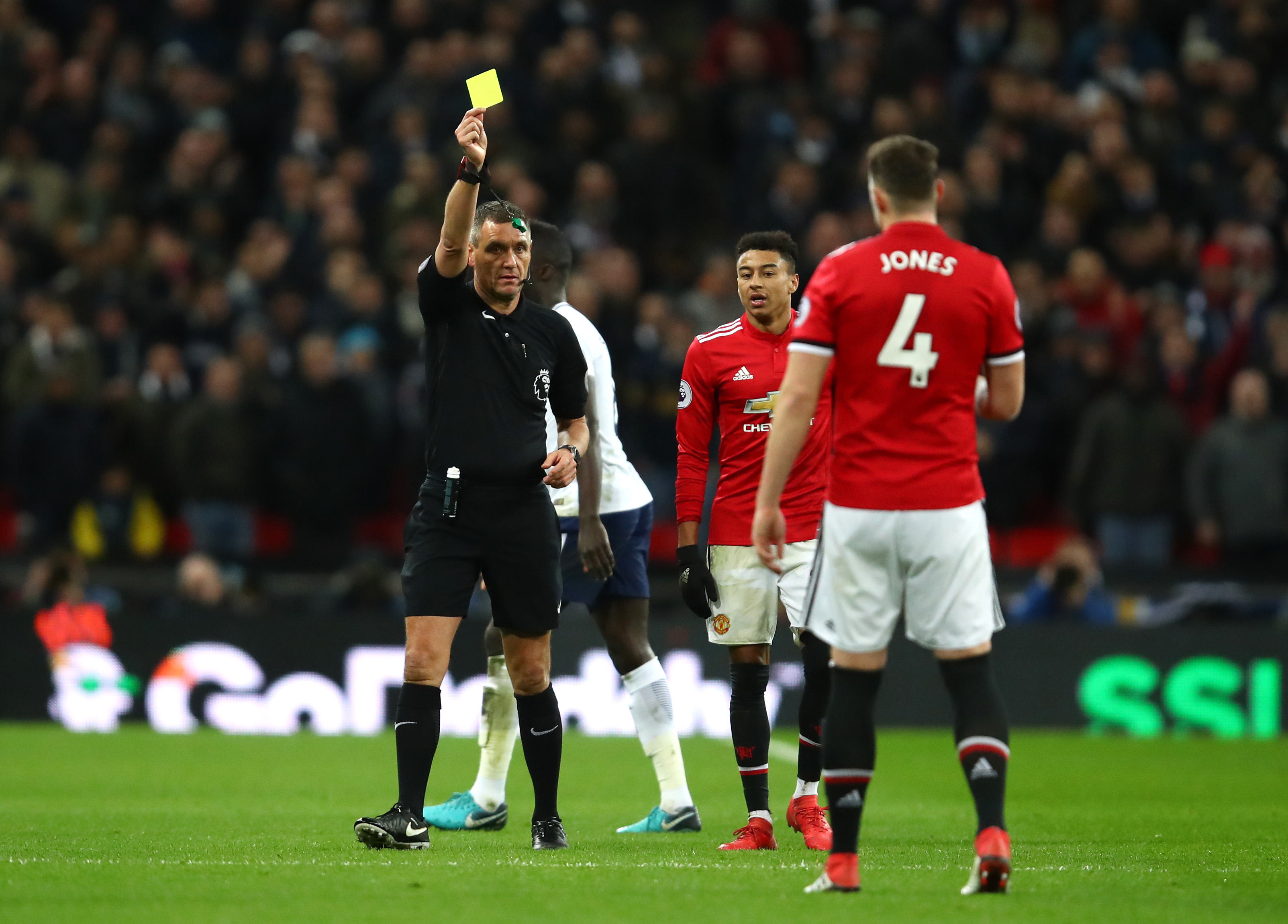 A sorry Phil Jones gets a booking for Manchester United.