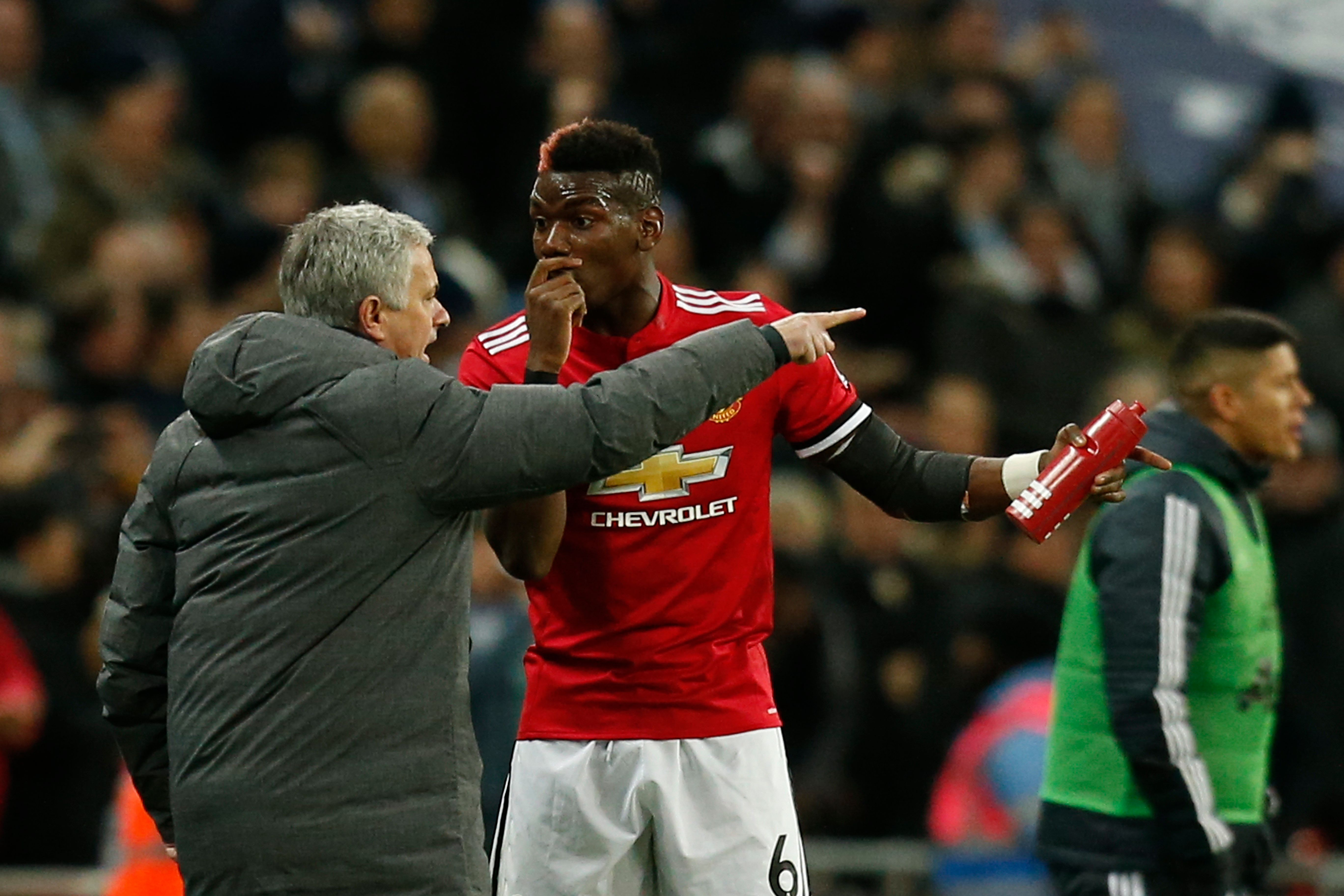 Paul Pogba and Jose Mourinho in conversation.
