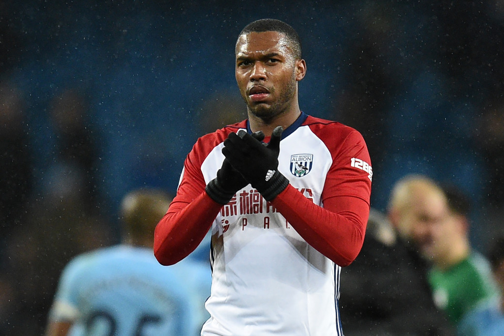 West Bromwich Albion's English striker Daniel Sturridge applauds supporters on the pitch after the English Premier League football match between Manchester City and West Bromwich Albion at the Etihad Stadium in Manchester, north west England, on January 31, 2018. Manchester City won the game 3-0. / AFP PHOTO / Oli SCARFF / RESTRICTED TO EDITORIAL USE. No use with unauthorized audio, video, data, fixture lists, club/league logos or 'live' services. Online in-match use limited to 75 images, no video emulation. No use in betting, games or single club/league/player publications. / (Photo credit should read OLI SCARFF/AFP/Getty Images)