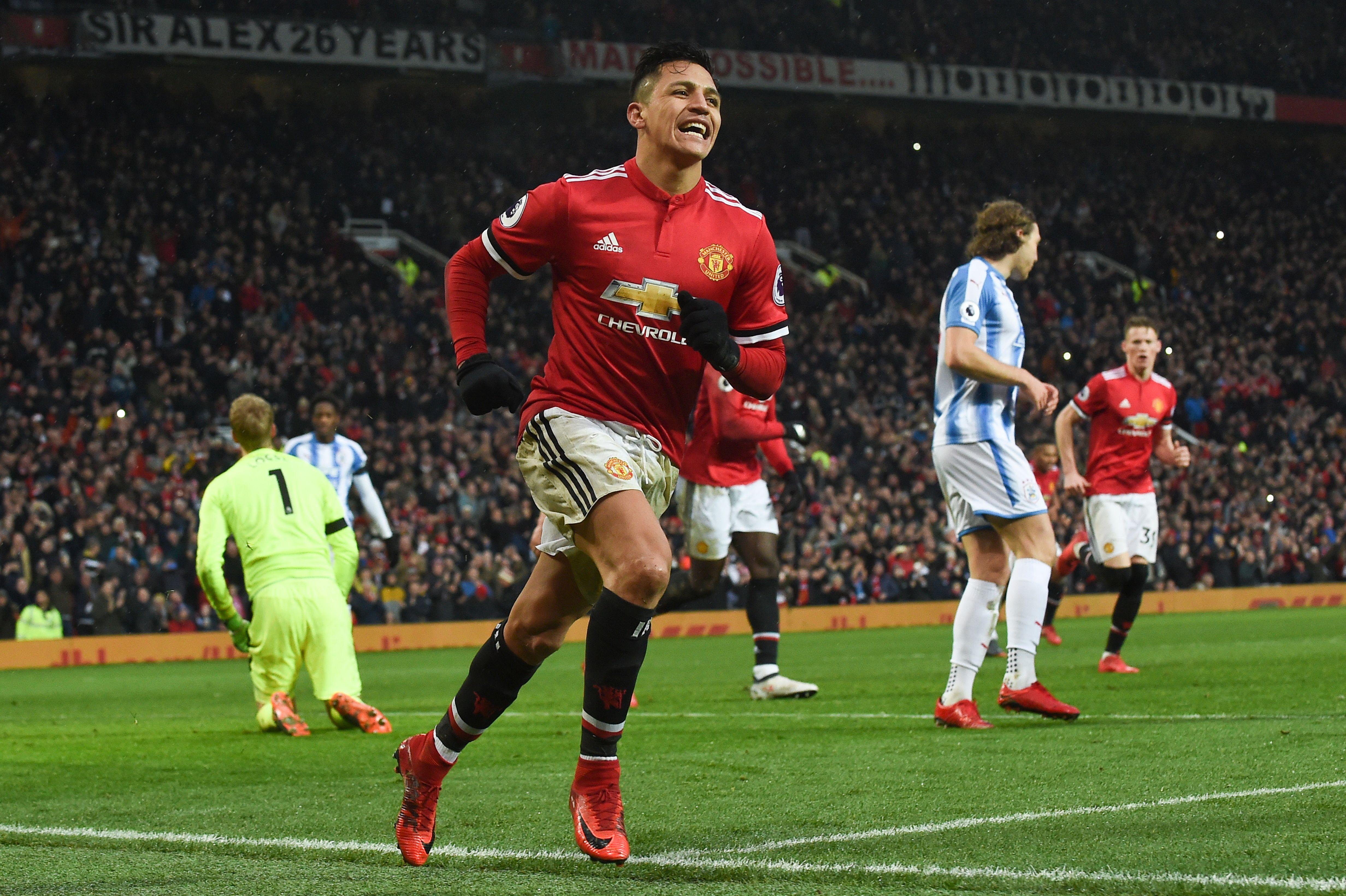 Alexis Sanchez celebrates his goal against Huddersfield.