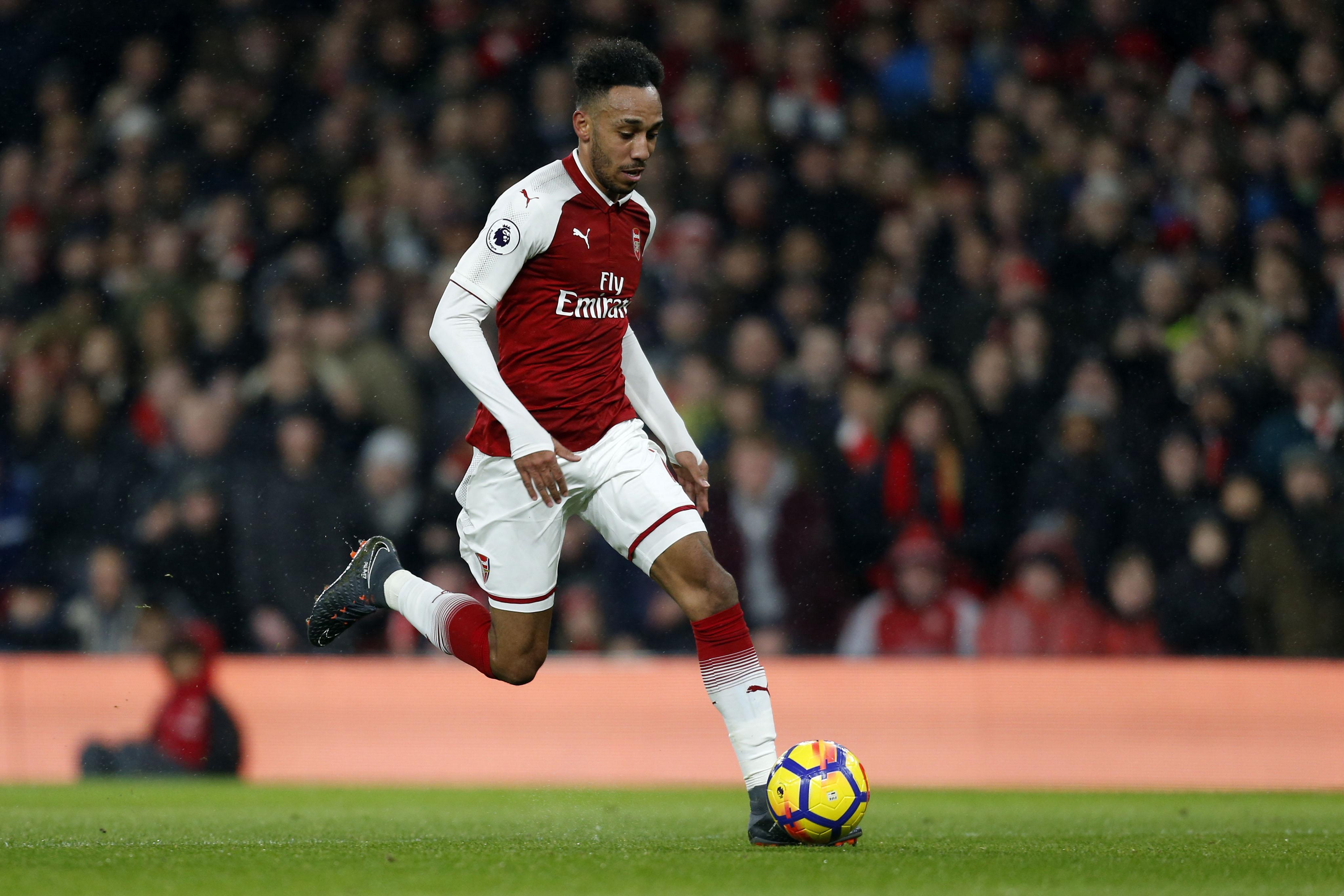Aubameyang in full flight for Arsenal.