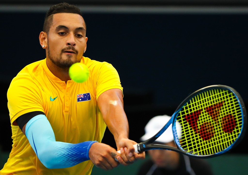 Nick Kyrgios of Australia hits a return to Alexander Zverev of Germany during their forth round of the Davis Cup World Group tennis match at the Pat Rafter Arena in Brisbane on February 4, 2018. / AFP PHOTO / Patrick HAMILTON / -- IMAGE RESTRICTED TO EDITORIAL USE - STRICTLY NO COMMERCIAL USE -- (Photo credit should read PATRICK HAMILTON/AFP/Getty Images)