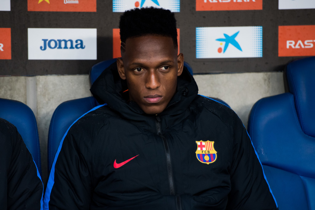 BARCELONA, SPAIN - FEBRUARY 04: Yerry Mina of FC Barcelona looks on from the bench during the La Liga match between Espanyol and Barcelona at RCDE Stadium on February 4, 2018 in Barcelona, Spain. (Photo by Alex Caparros/Getty Images)