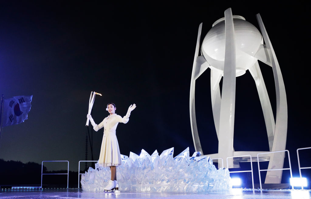 South Korean figure skating queen Kim Yuna lit the Olympic flame.
