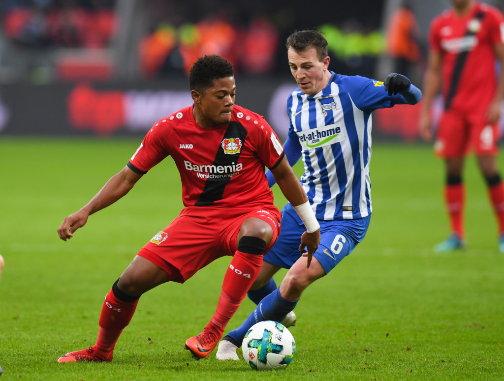 Leverkusen's Jamaican midfielder Leon Bailey (L) and Berlin's Czech midfielder Vladimir Darida vie for the ball during the German first division Bundesliga football match Bayer 04 Leverkusen vs Hertha BSC Berlin, in Leverkusen, western Germany, on February 10, 2018. / AFP PHOTO / Patrik STOLLARZ / RESTRICTIONS: DURING MATCH TIME: DFL RULES TO LIMIT THE ONLINE USAGE TO 15 PICTURES PER MATCH AND FORBID IMAGE SEQUENCES TO SIMULATE VIDEO. == RESTRICTED TO EDITORIAL USE == FOR FURTHER QUERIES PLEASE CONTACT DFL DIRECTLY AT + 49 69 650050 (Photo credit should read PATRIK STOLLARZ/AFP/Getty Images)