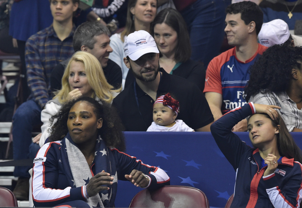 ASHEVILLE, NC - FEBRUARY 10: Serena Williams of Team USA, bottom left, along with her husband Alexis Ohanian and their daughter Alexis Olympia, center, watch the action during the first round of the 2018 Fed Cup at US Cellular Center on February 10, 2018 in Asheville, North Carolina. (Photo by Richard Shiro/Getty Images)