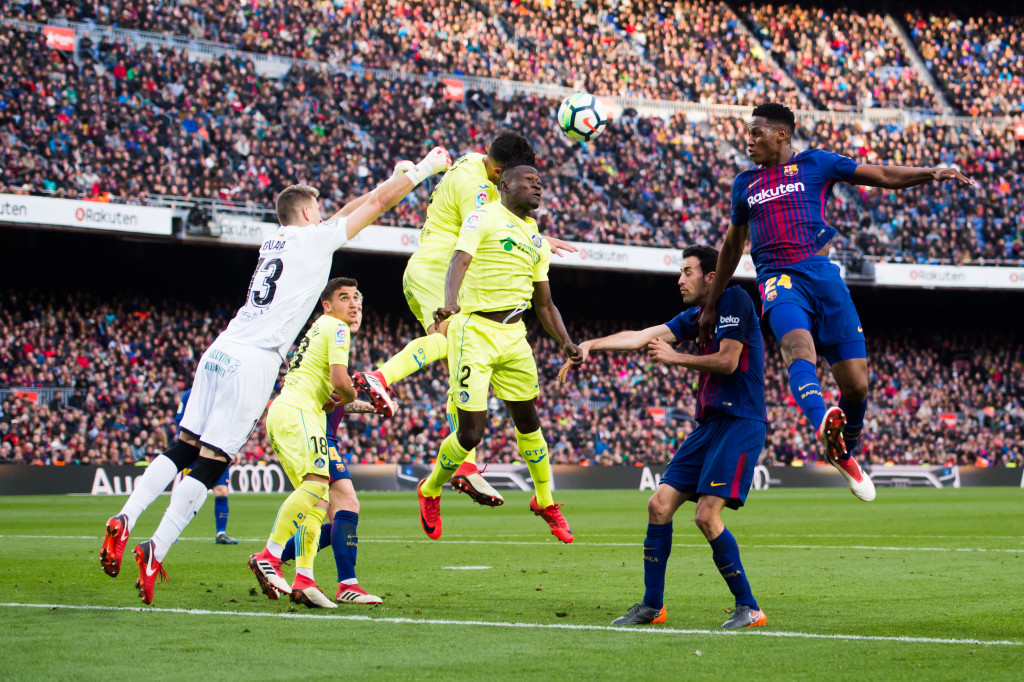 BARCELONA, SPAIN - FEBRUARY 11: Yerry Mina of FC Barcelona heads for the ball during the La Liga match between Barcelona and Getafe at Camp Nou on February 11, 2018 in Barcelona, Spain. (Photo by Alex Caparros/Getty Images)