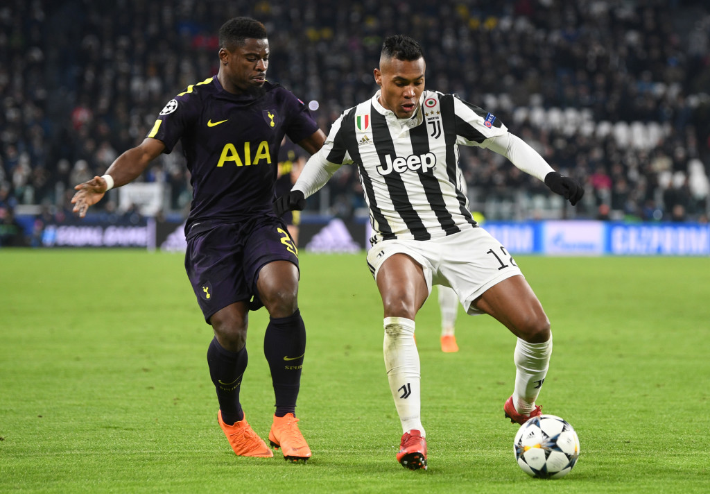 TURIN, ITALY - FEBRUARY 13: Alex Sandro of Juventus is challenged by Serge Aurier of Tottenham Hotspur during the UEFA Champions League Round of 16 First Leg match between Juventus and Tottenham Hotspur at Allianz Stadium on February 13, 2018 in Turin, Italy. (Photo by Michael Regan/Getty Images)