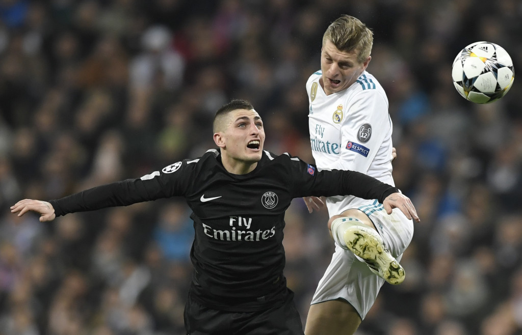 Paris Saint-Germain's Italian midfielder Marco Verratti (L) vies with Real Madrid's German midfielder Toni Kroos (R) during the UEFA Champions League round of sixteen first leg football match Real Madrid CF against Paris Saint-Germain (PSG) at the Santiago Bernabeu stadium in Madrid on February 14, 2018. / AFP PHOTO / GABRIEL BOUYS (Photo credit should read GABRIEL BOUYS/AFP/Getty Images)