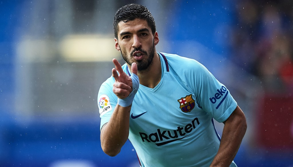 Kiss the rain: Suarez makes it 1-0 at the Ipurua Municipal Stadium.