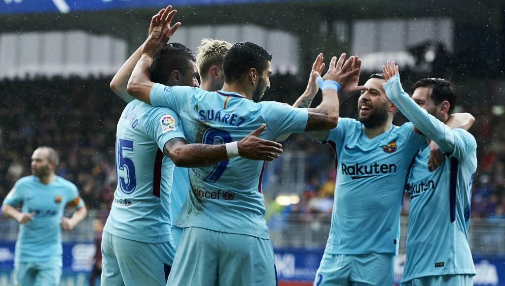 Barca players celebrate Suarez's opener.