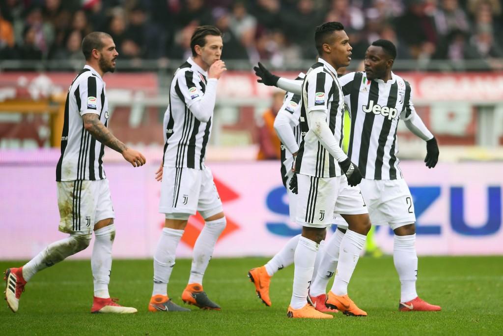 Juventus' Brazil star Alex Sandro (2nd r) celebrates after scoring.
