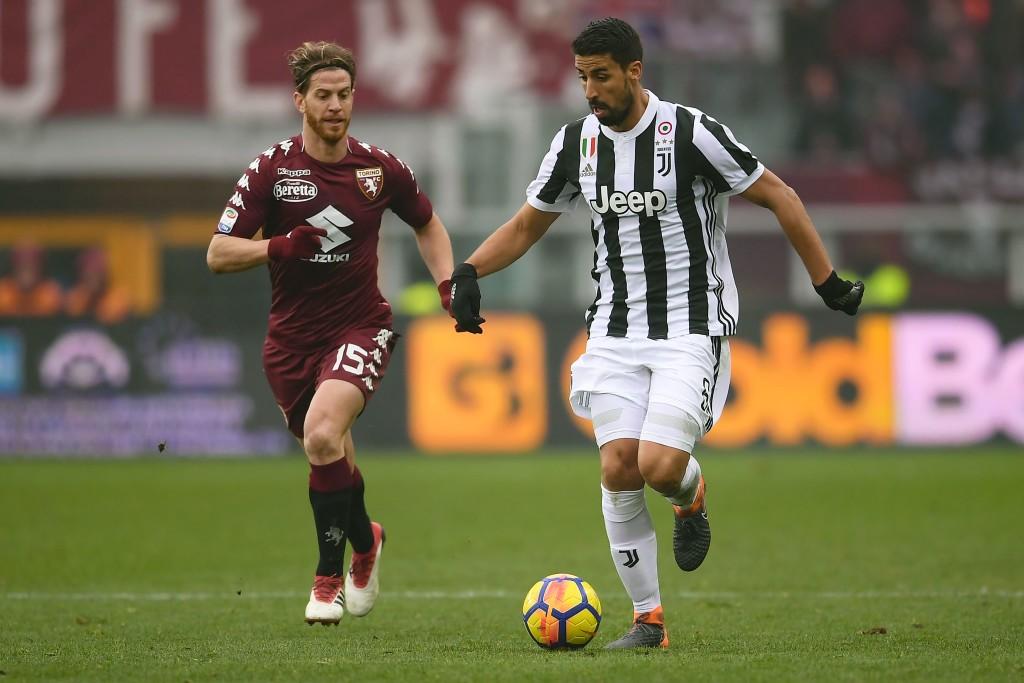 Torino defender Cristian Ansaldi lL) vies with Juventus' German midfielder Sami Khedira.