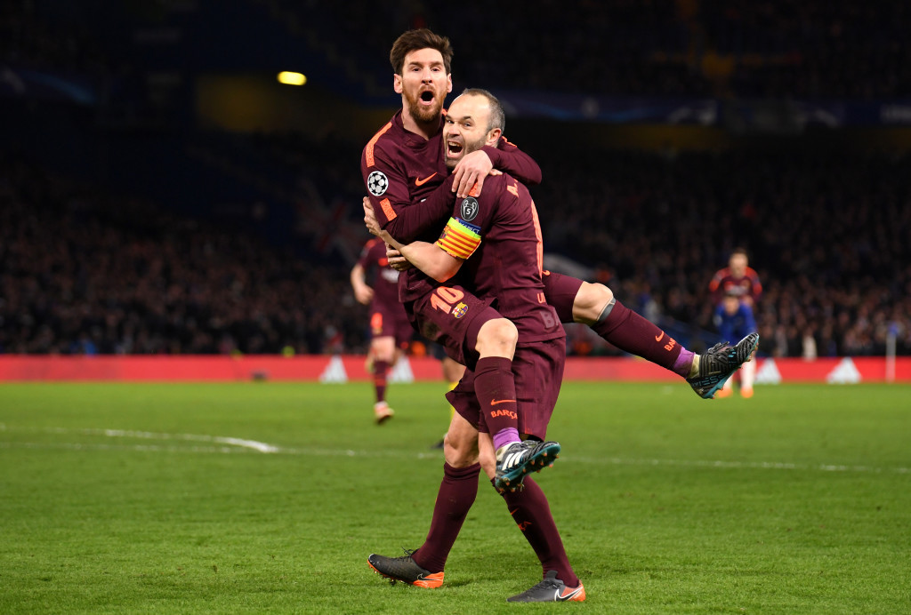 Lionel Messi and Andres Iniesta celebrate for Barcelona.