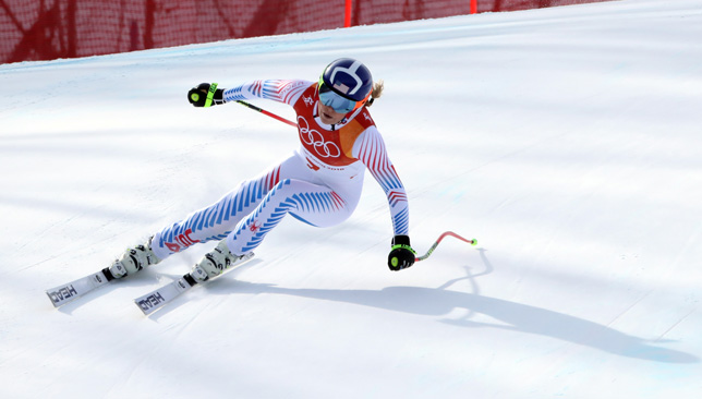 Alpine skiing - Vonn leads Mowinckel after combined downhill, Shiffrin lurks