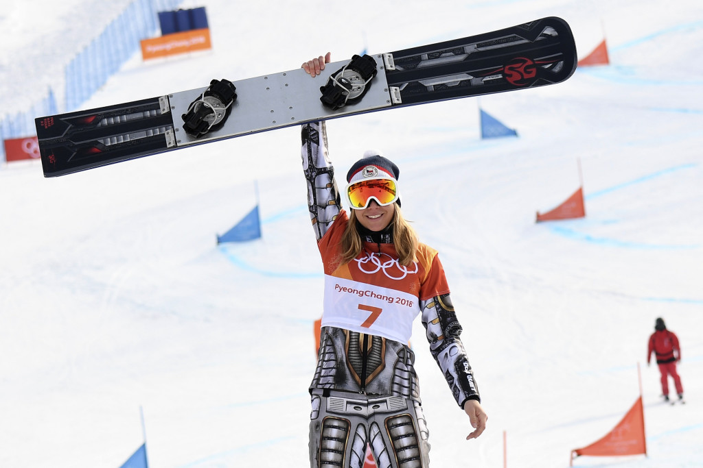 TOPSHOT - Gold medallist Czech Republic's Ester Ledecka celebrates on the podium during the victory ceremony for the women's snowboard parallel giant slalom event at the Phoenix Park during the Pyeongchang 2018 Winter Olympic Games on February 24, 2018 in Pyeongchang. / AFP PHOTO / LOIC VENANCE (Photo credit should read LOIC VENANCE/AFP/Getty Images)