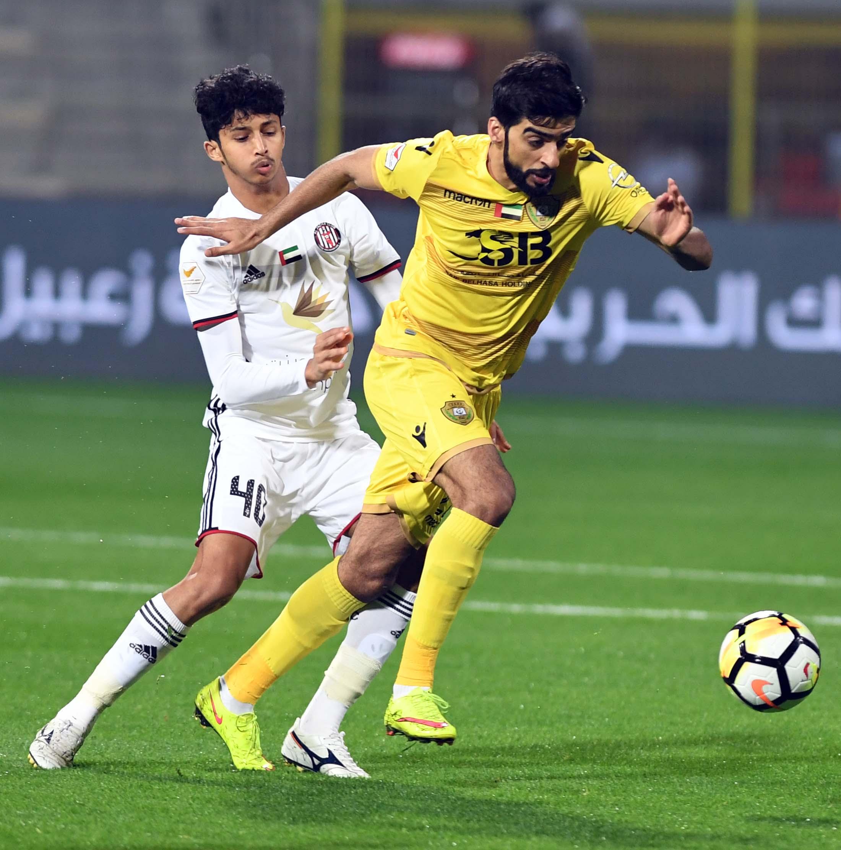 Al Wasl goal scorer Hassan Mohammed (r).