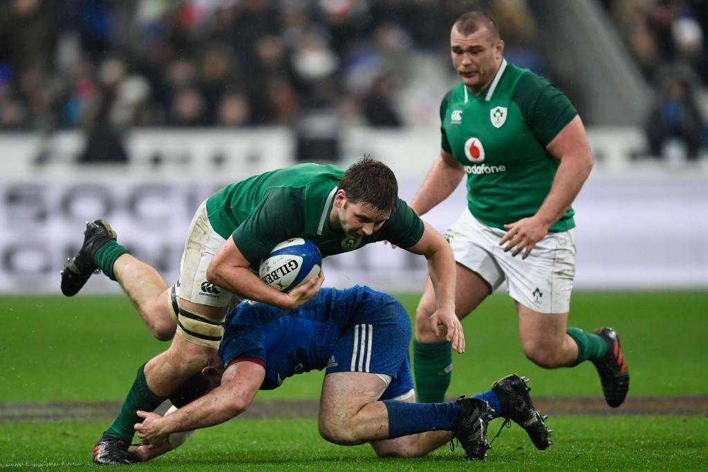 Ireland lock Iain Henderson gets chopped down