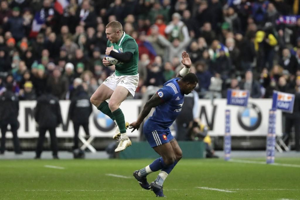 Keith Earls leaps high to take Sexton's cross field kick