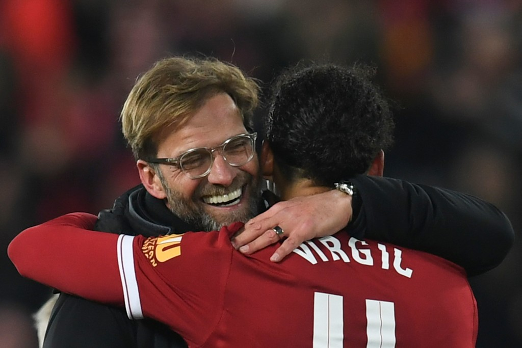 Liverpool's German manager Jurgen Klopp (L) hugs Liverpool's Dutch defender Virgil van Dijk (R) at the end of the English FA Cup third round football match between Liverpool and Everton at Anfield in Liverpool, north west England on January 5, 2018. / AFP PHOTO / Paul ELLIS / RESTRICTED TO EDITORIAL USE. No use with unauthorized audio, video, data, fixture lists, club/league logos or 'live' services. Online in-match use limited to 75 images, no video emulation. No use in betting, games or single club/league/player publications.  /         (Photo credit should read PAUL ELLIS/AFP/Getty Images)