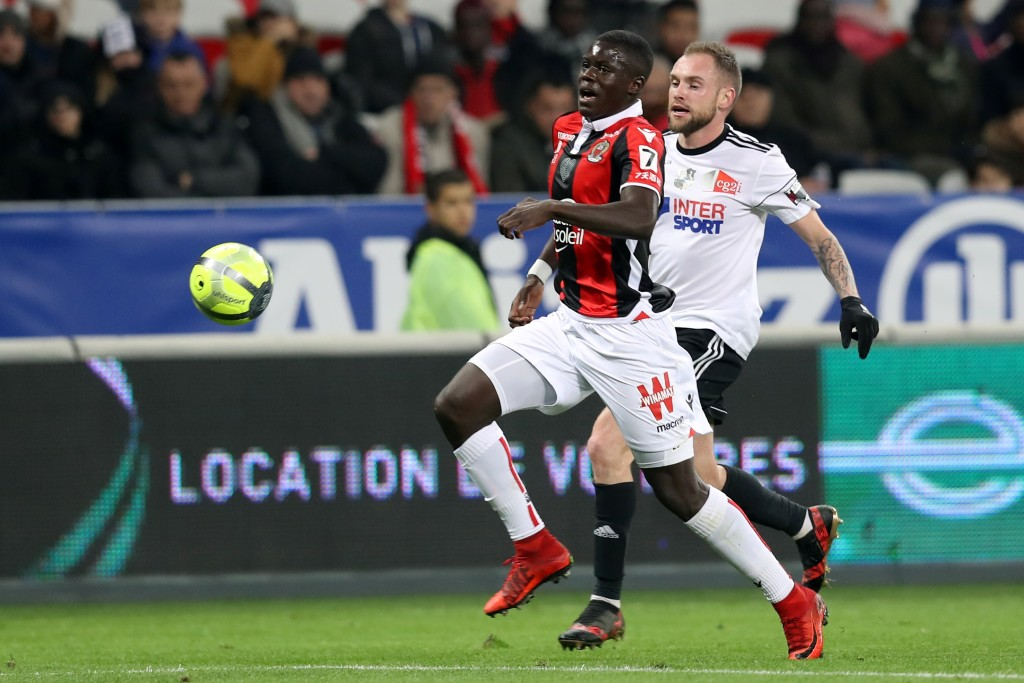 "Nice's French defender Malang Sarr (L) vies with Amiens' French midfielder Emmanuel Bourgaud (R) during the French L1 football match Nice vs Amiens on January 13, 2018 at the ""Allianz Riviera"" stadium in Nice, southeastern France. / AFP PHOTO / VALERY HACHE (Photo credit should read VALERY HACHE/AFP/Getty Images)"
