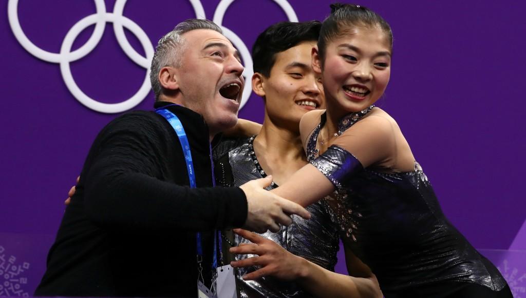 Ryom Tae-Ok (r) and Kim Ju-Sik (c) react to their winning score.