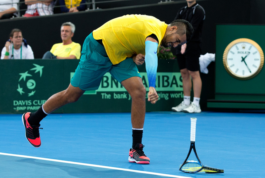 Nick Kyrgios takes it out on his racket
