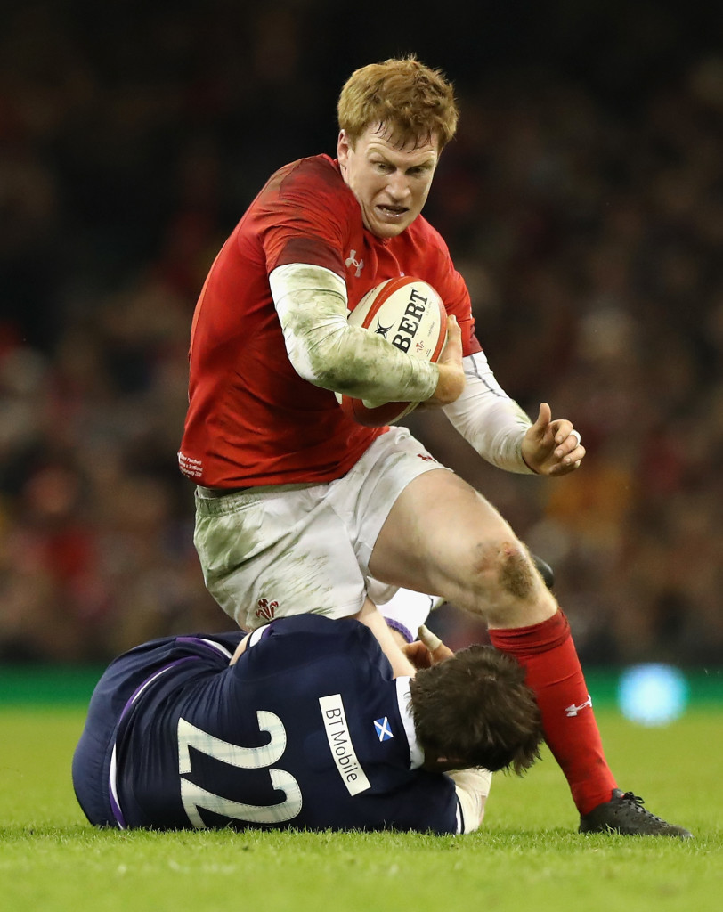 CARDIFF, WALES - FEBRUARY 03: Rhys Patchell of Wales is tackled by Pete Horne during the NatWest Six Nations match between Wales and Scotland at the Principality Stadium on February 3, 2018 in Cardiff, Wales. (Photo by David Rogers/Getty Images)
