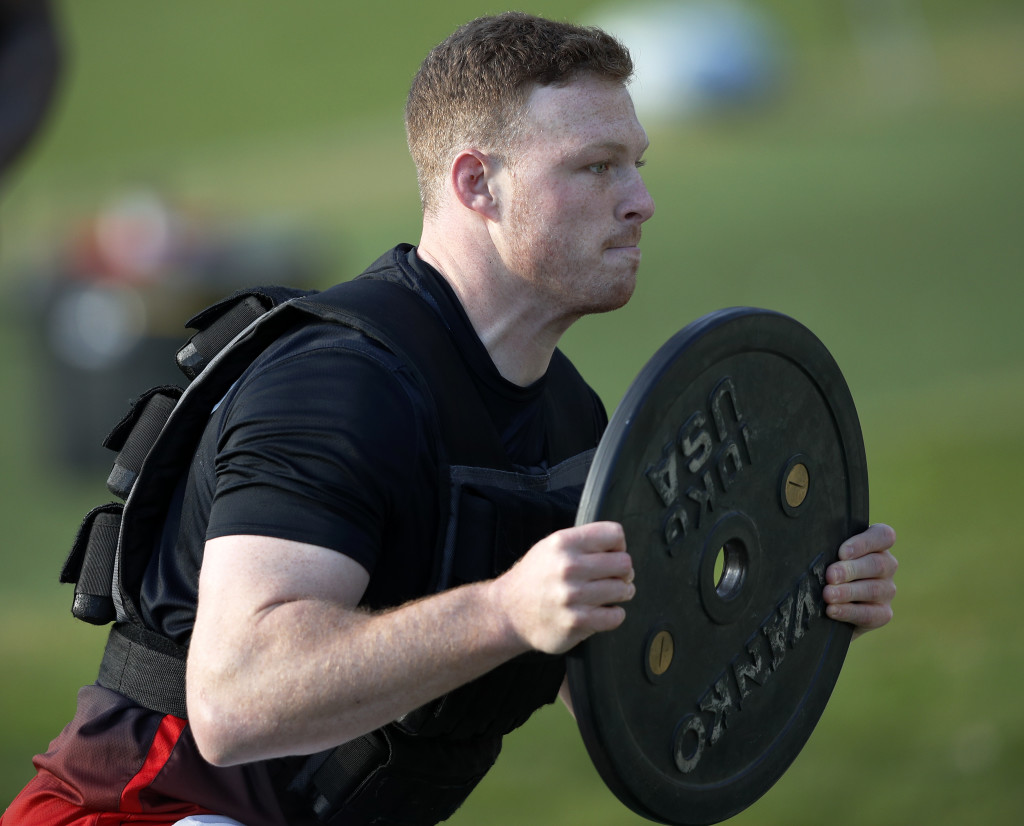 England's number 8 Sam Simmonds runs with weights during a team training session at Pennyhill Park in Bagshot, some 40 miles west of London on February 2, 2018. England play Italy in their opening Six Nations Championship match in Rome on February 4, 2018. / AFP PHOTO / ADRIAN DENNIS (Photo credit should read ADRIAN DENNIS/AFP/Getty Images)