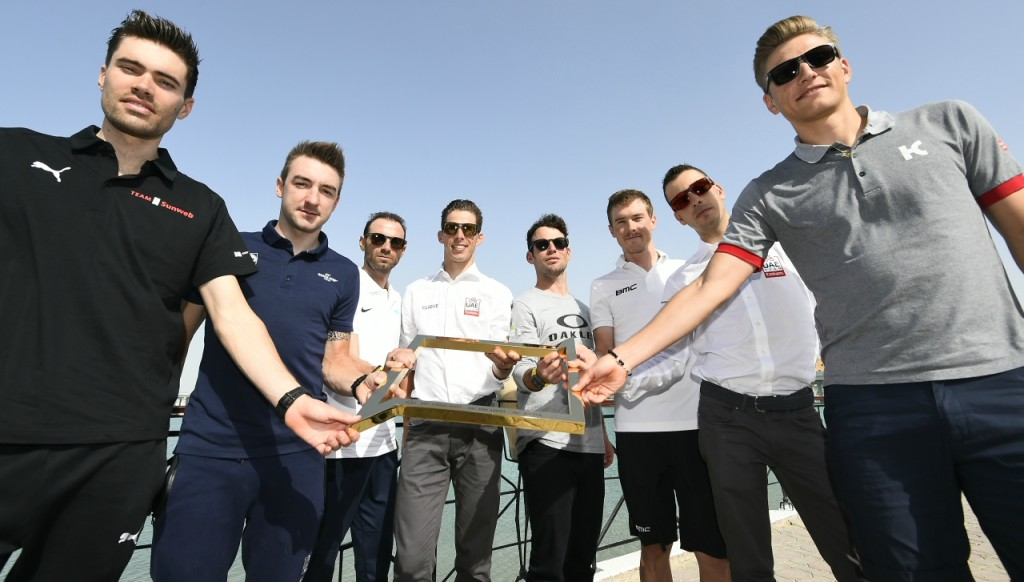 Tom Dumoulin (l) poses with other riders at Yas Marina Circuit with the Abu Dhabi Tour trophy on Tuesday.