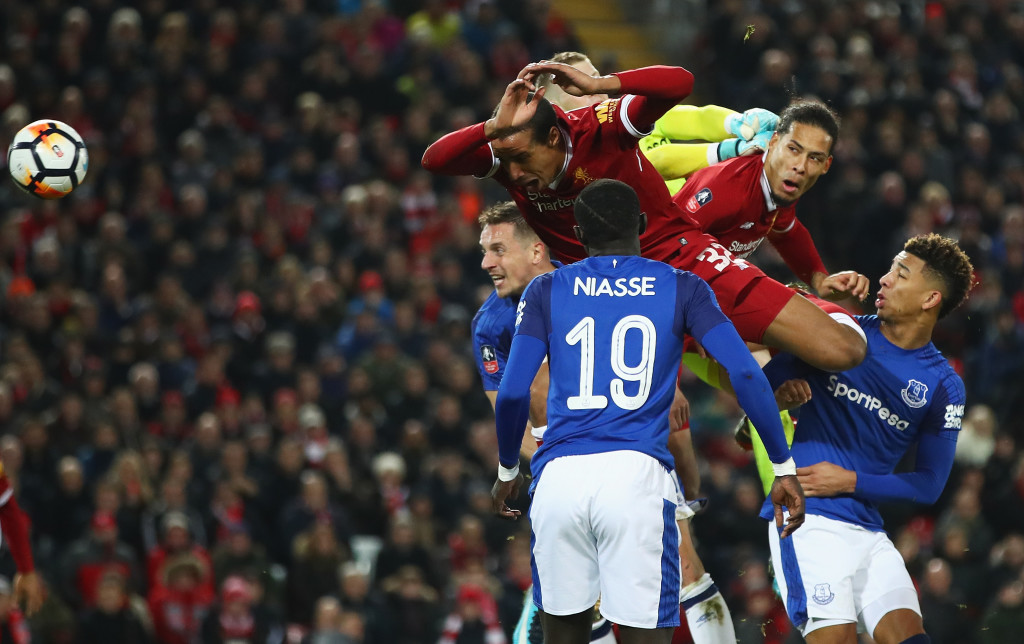 LIVERPOOL, ENGLAND - JANUARY 05: Virgil van Dijk of Liverpool (2R) scores their second goal during the Emirates FA Cup Third Round match between Liverpool and Everton at Anfield on January 5, 2018 in Liverpool, England. (Photo by Clive Brunskill/Getty Images)