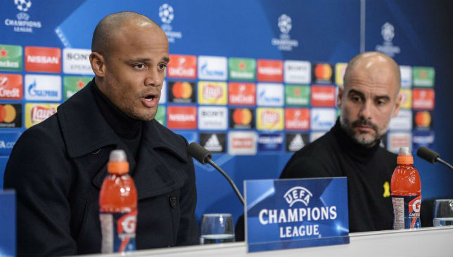 Vincent Kompany (L) and Manchester City's Spanish coach Pep Guardiola