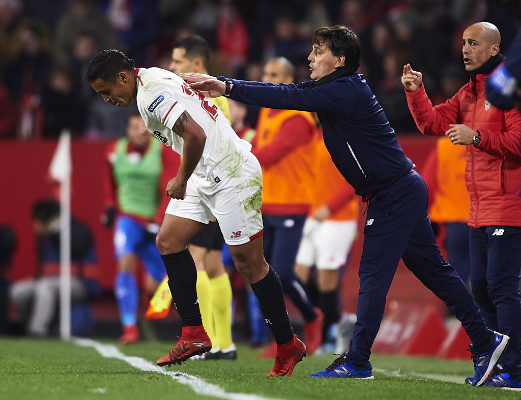 SEVILLE SPAIN- JANUARY 28 Luis Muriel of Sevilla FC celebrates after scoring the first goal for Sevilla FC with his coach Vincenzo Montella of Sevilla FC during the La Liga match between Sevilla and Getafe at Estadio Ramon Sanchez Pizjuan on Janua