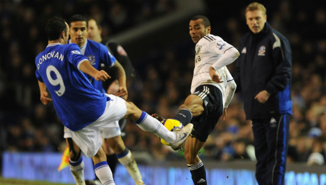 Ashley Cole of Chelsea is injured in a challenge by Landon Donovan of Everton