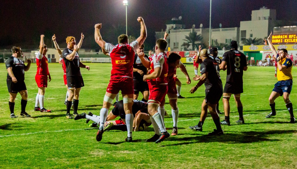 Bahrain players rejoice after scoring a try in the final against Exiles.