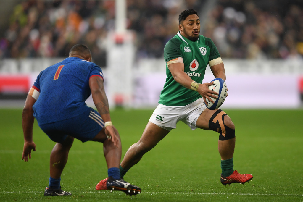 PARIS, FRANCE - FEBRUARY 03: Bundee Aki of Ireland takes on Jefferson Poirot of France during the NatWest Six Nations match between France and Ireland at Stade de France on February 3, 2018 in Paris, France. (Photo by Mike Hewitt/Getty Images)