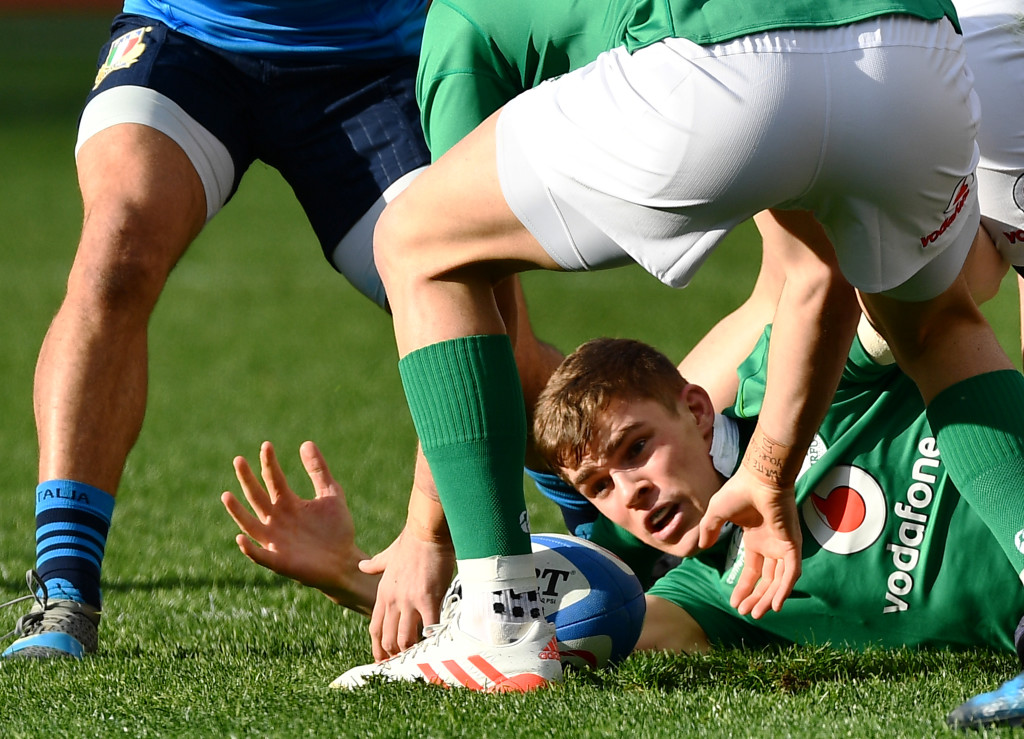 TOPSHOT - Ireland's Garry Ringrose (bottom) catches the ball during the team's Six Nations rugby union match Italy against Ireland at the Olympic Stadium in Rome on February 11, 2017. / AFP PHOTO / Vincenzo PINTO (Photo credit should read VINCENZO PINTO/AFP/Getty Images)