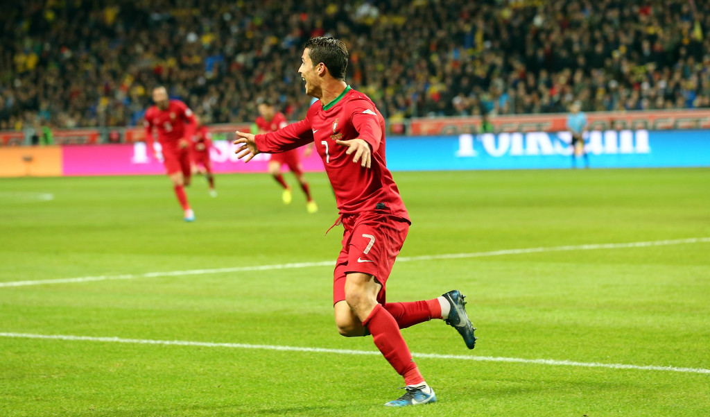 STOCKHOLM, SWEDEN - NOVEMBER 19: Cristiano Ronaldo of Portugal celebrates after scoring their 3rd goal during the FIFA 2014 World Cup Qualifier Play-off Second Leg match between Sweden and Portugal at Friends Arena on November 19, 2013 in Stockholm, Sweden. (Photo by Martin Rose/Getty Images,)