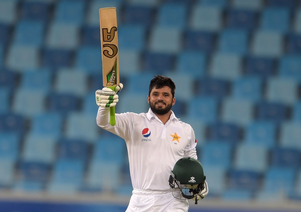 Pakistani batsman Azhar Ali celebrates after scoring double century (200 runs) on the second day of first day-night test between Pakistan and the West Indies at the Dubai International Cricket Stadium in the Gulf Emirate on October 14, 2016. / AFP / AAMIR QURESHI (Photo credit should read AAMIR QURESHI/AFP/Getty Images)