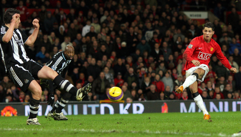 Cristiano Ronaldo (R) of Manchester United scores his third goal during the Premier league football match against Newcastle United at Old Trafford, Manchester , north-west England, 12 January 2008. AFP PHOTO/ANDREW YATES Mobile and website use of domestic English football pictures are subject to obtaining a Photographic End User Licence from Football DataCo Ltd Tel : +44 (0) 207 864 9121 or e-mail accreditations@football-dataco.com - applies to Premier and Football League matches. (Photo credit should read ANDREW YATES/AFP/Getty Images)