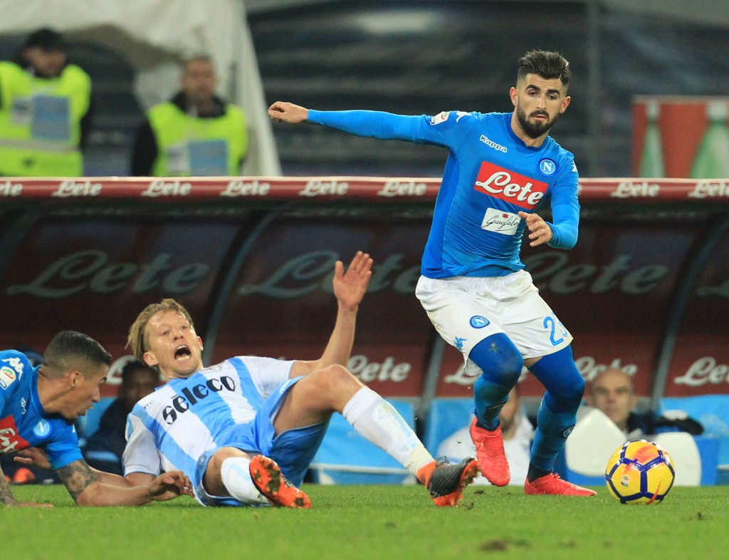 Napoli's Albanian defender Elseid Hysaj (R) vies with Lazio's Brazilian midfielder Lucas Leiva (C) during the Italian Serie A football match Napoli versus Lazio on February 10, 2018 at San Paolo stadium in Naples. / AFP PHOTO / CARLO HERMANN (Photo credit should read CARLO HERMANN/AFP/Getty Images)