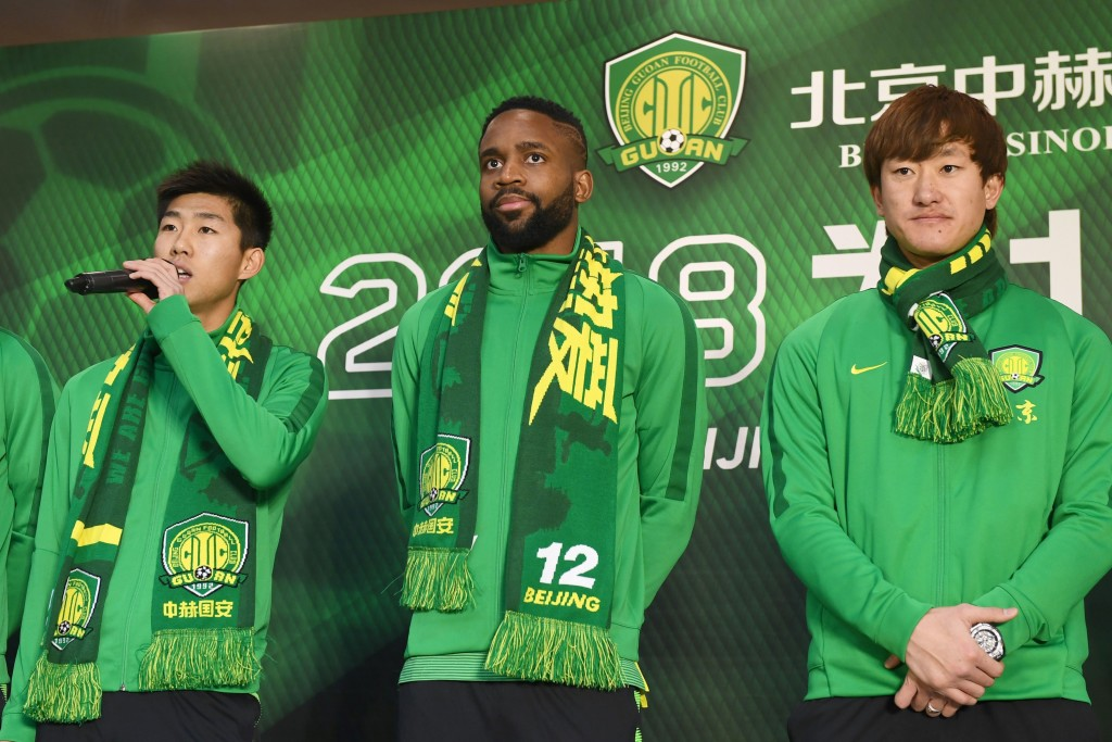 Cedric Bakambu (c) stands with his new Beijing Guoan team-mates.