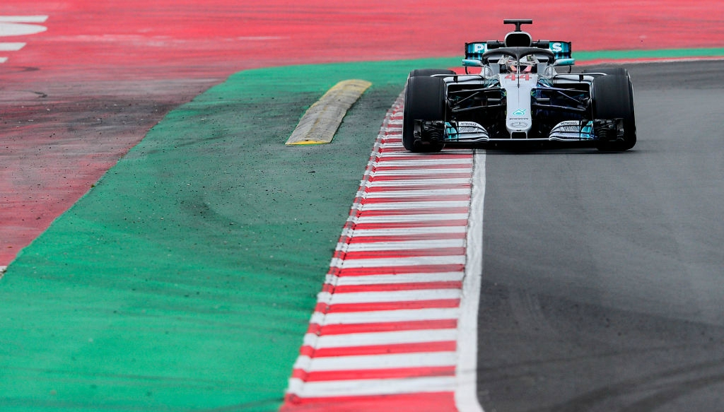 Hamilton itching to race after setting Barca benchmark