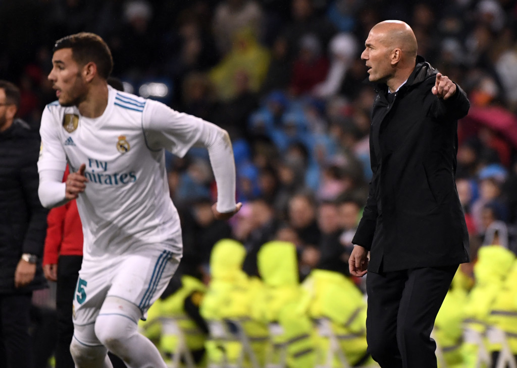 Real Madrid's French coach Zinedine Zidane (R) gives instructions beside Real Madrid's French defender Theo Hernandez during the Spanish league football match Real Madrid CF against Getafe CF at the Santiago Bernabeu stadium in Madrid on March 3, 2018. / AFP PHOTO / PIERRE-PHILIPPE MARCOU (Photo credit should read PIERRE-PHILIPPE MARCOU/AFP/Getty Images)